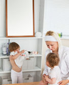 Mother taking care of her children — Stock Photo