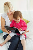 Mother and daughter having fun with a laptop — Stock Photo