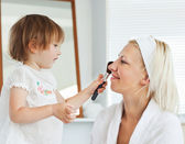 Beaming mother taking care of her child — Stock Photo