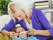 Mother taking care of her sick child — Stock Photo