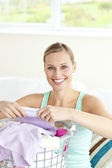 Cheerful young woman doing the laundry — Stock Photo