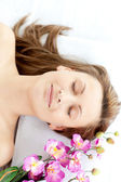 Laid-back woman having a massage — Stock Photo