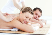 Affectionate couple having a back massage with closed eyes — Stock Photo