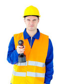 Young male worker wearing helmet and holding boring machine — Stock Photo