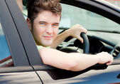 Happy young male driver sitting in his car — Stock Photo