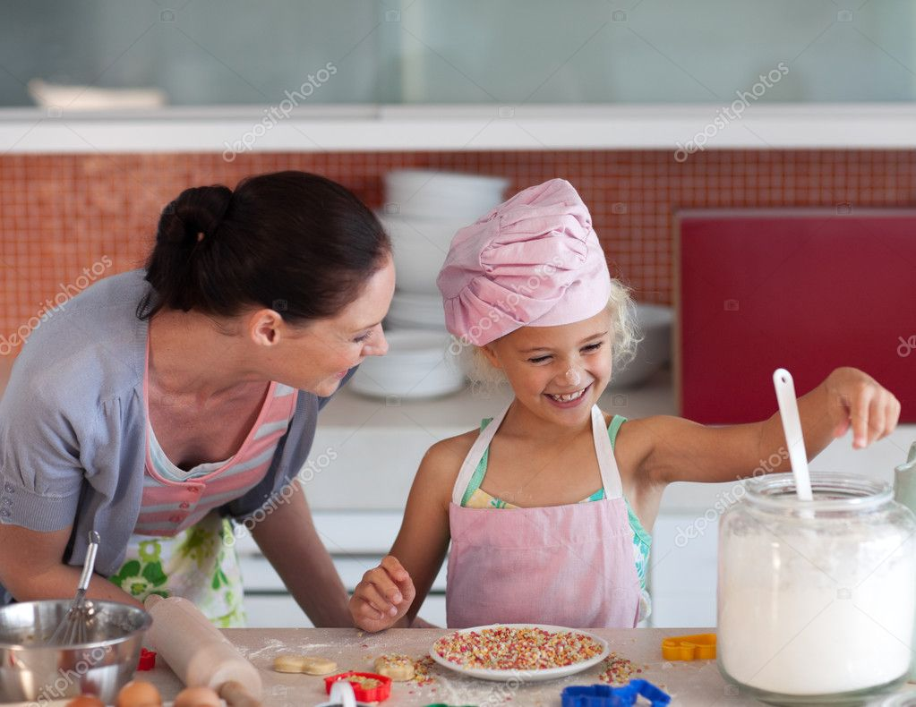 Young mother in kitchen teaching child how to cook  Stock Photo #10821255