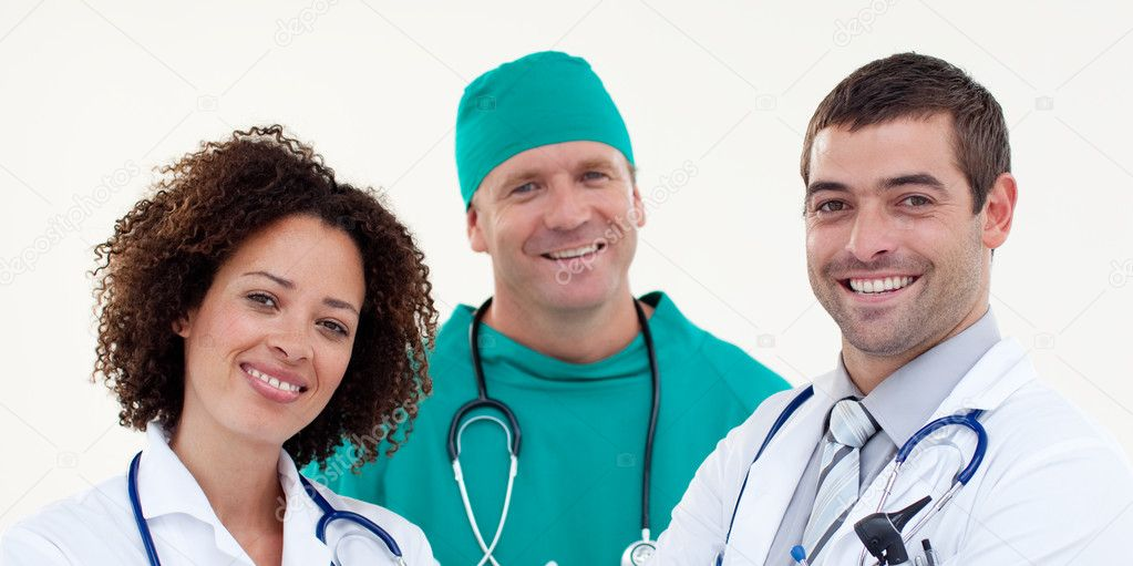 Friendly looking medical team against white background — Foto Stock #10821685
