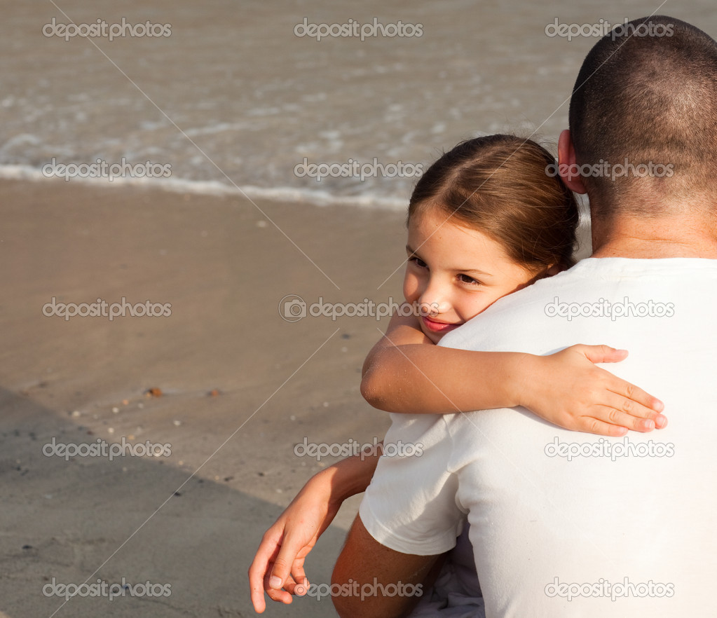 Portrait of a Young Daughter Hugging his father on the beach — Stock Photo #10822228