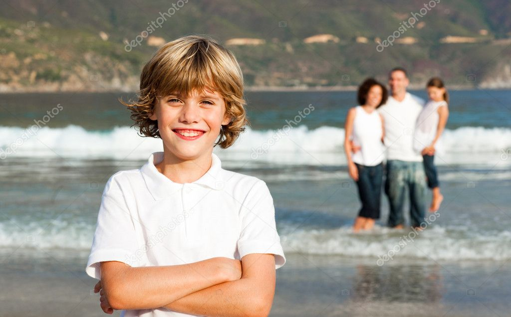 Young Family Enjoying the stroll on the beach — Stock Photo #10822262