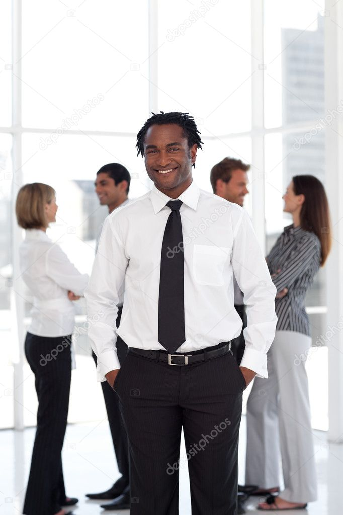 Afro male manager with his team in a office — Stock Photo #10822574