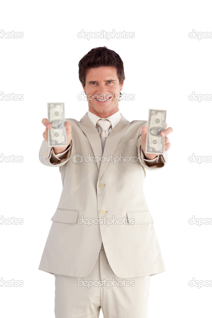 Handsome Businessman holding Dollars against a white background — Stock Photo #10822799