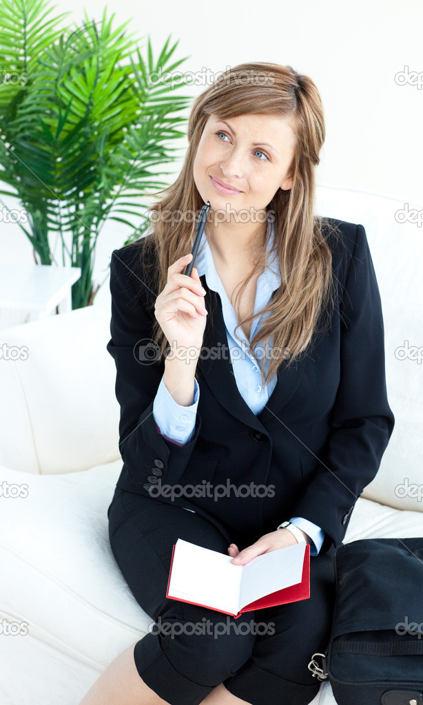 Thoughtful businesswoman taking notes sitting in the office — Stock Photo #10823703