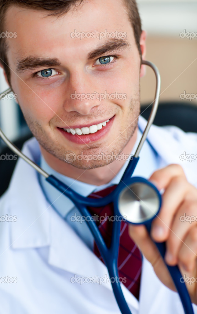 Glowing doctor holding a stethoscope against a white background — Stock Photo #10824186