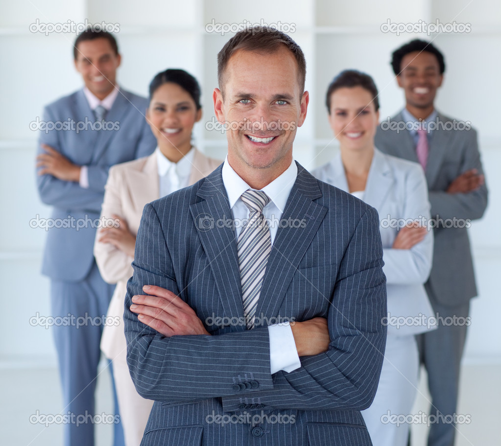 Smiling business manager standing in office leading his team — Stock Photo #10825054