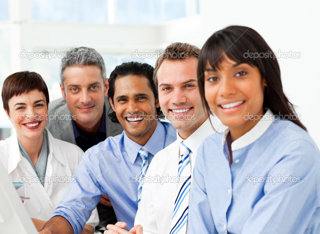 Portrait of ambitious business team at work in the office — Stock Photo #10825393