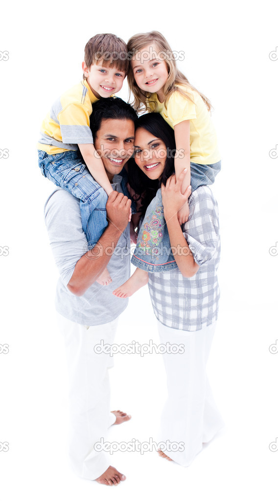Smiling parents giving their children piggyback ride against a white background  Stock Photo #10825643