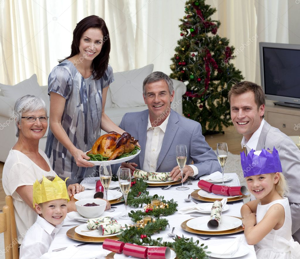 Family celebrating Christmas dinner with turkey at home — Stock Photo #10826146