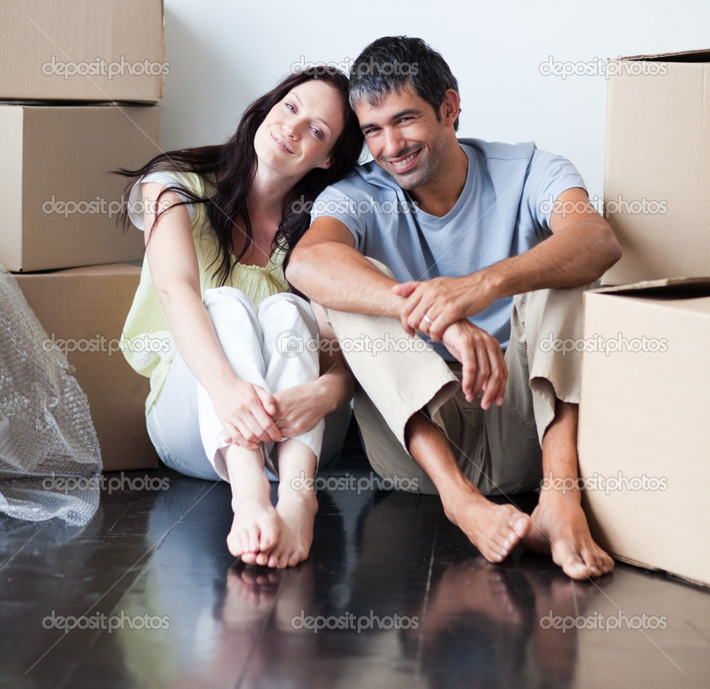 Happy couple moving to their new house  Stock Photo #10826526