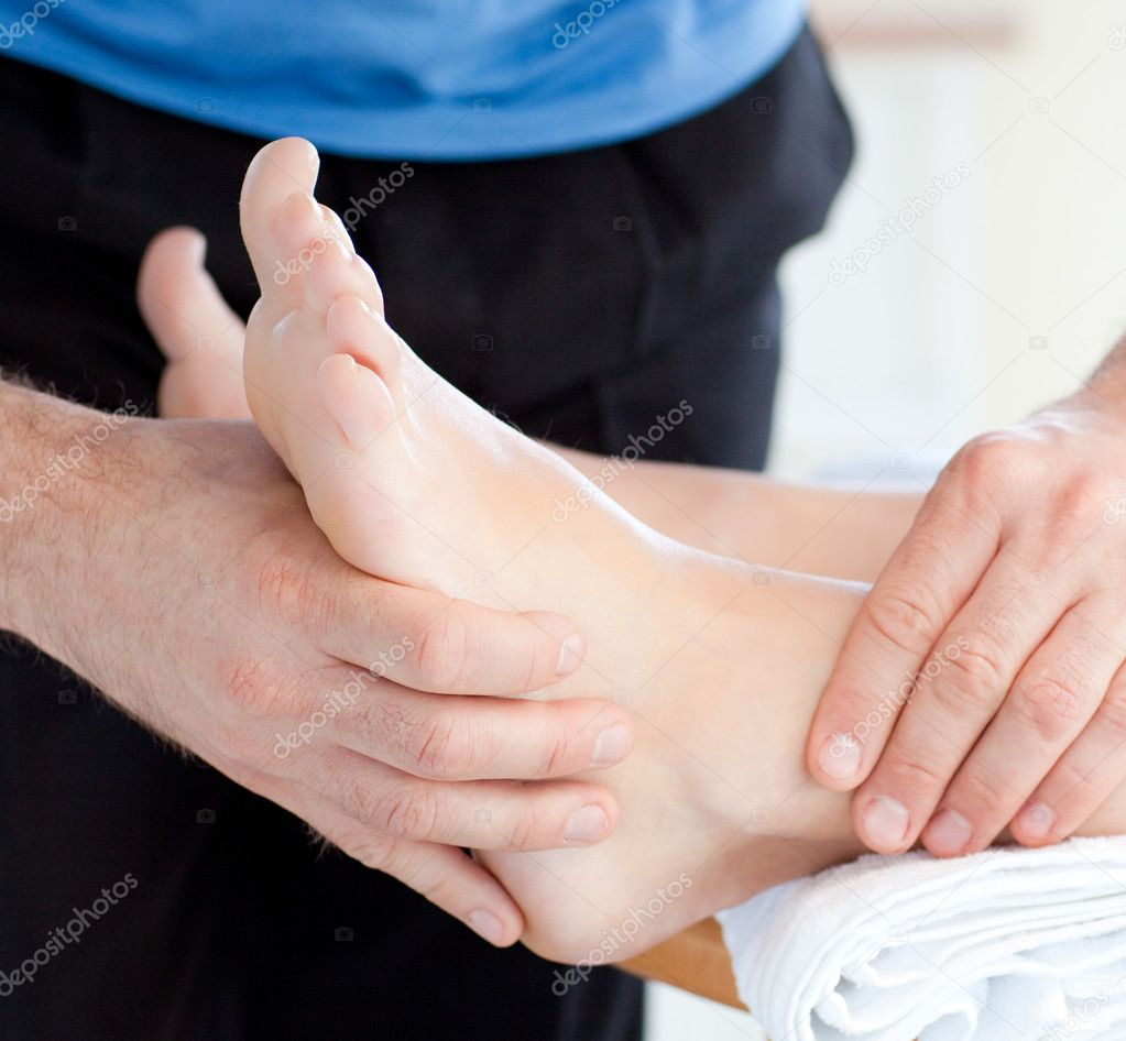 Close-up of a woman enjoying a foot massage in a health club — Stock Photo #10826585