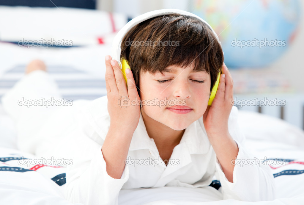 Cute boy listenning music in a bedroom  Stock Photo #10827050