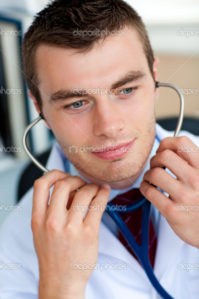 Bright male doctor holding a stethoscope   Stock Photo #10827103