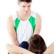 Attractive man doing fitness exercises with a woman — Stock Photo