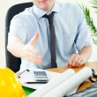 Confident businessman reaching his hand to the camera — Stock Photo