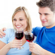 Affectionate couple drinking wine sitting on a sofa — Stock Photo #10830037