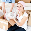 Stock Photo: Animated young couple packing box