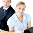 Attractive couple of businesspeople using their laptop at the ta — Stock Photo #10830113