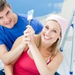 Hugging couple having fun while painting a room — Stock Photo
