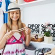 Bright young woman choosing a necklace — Stock Photo