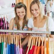 Animated female friends doing shopping — Stock Photo