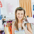Beautiful blond woman holding shopping bags smiling at the camer — Stock Photo