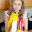 Beautiful blond womholding cleansing agent into camera — Stock Photo #10830257