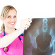 Stock Photo: Glowing young surgeon holding x-ray