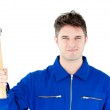 Smiling mechanic holding a hammer looking at the camera — Stock Photo