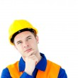 Pensive white collar worker with a hardhat — Stock Photo