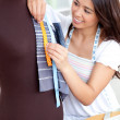 Bright asian woman working with clothes — Stock Photo
