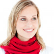 Portrait of a captivating woman with a red scarf — Stock Photo