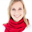 Portrait of a beautful woman with a red scarf smiling at the cam — Stock Photo