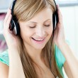 Animated caucasian woman listen to musik with headphones — Stock Photo