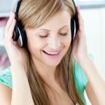 Animated caucasian woman listen to musik with headphones — Stock Photo