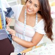 Pretty asian woman sewing at home — Stock Photo