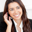 Portrait of an attractive asian businesswoman talking on phone w — Stock Photo #10830881