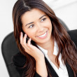 Stock Photo: Animated asibusinesswomtalking on phone