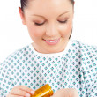 Positive female patient taking pills — Stock Photo #10830939