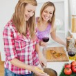 Delighted friends cooking spaghetties — Stockfoto #10831029