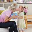 Cute little girl giving he mother present — Stock Photo #10831139