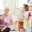 Delighted mother get surprise by her daughters — Stock Photo
